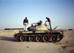 "TheKnowmad examines Iraqui tank, Kuwait oil fields after the ""Mother of all Battles""."